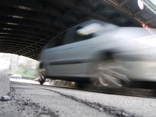 cars driving through tunnel