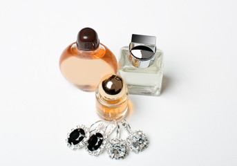 closeup of perfume bottle and jewelry set