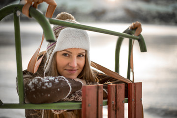 Portrait of a beautiful girl with sledges