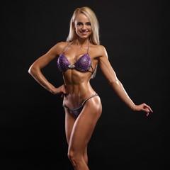 Sexy bodybuilder woman in black bikin