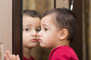 boy near mirror