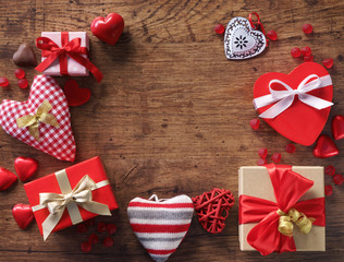Valentine's day background with heart shapes on wooden table. View from above