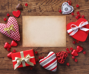 Valentine message on old paper on wooden background. Valentines Day concept
