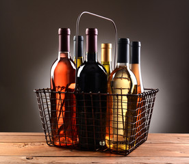 A Wire Shopping Basket Filled With Wine Bottles