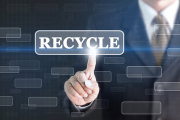 Businessman pressing RECYCLE concept button. Can be used in advertising