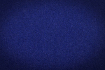 Dark blue paper with vignette, a background or texture