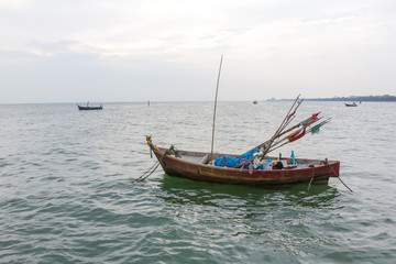 small boat fishing on bang san beach chonburi, Thailand