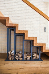 Photo sur Plexiglas Escalier modern solution to storage pile of wood under the stairs at home