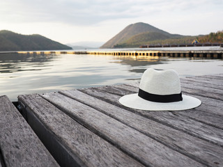 A white hat on wooden floor