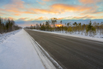 road in winter at dawn