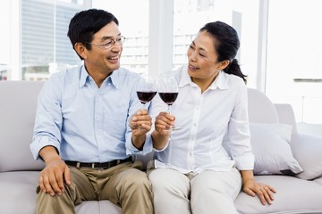 Man and woman with glasses of wine