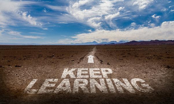 Keep Learning written on desert road