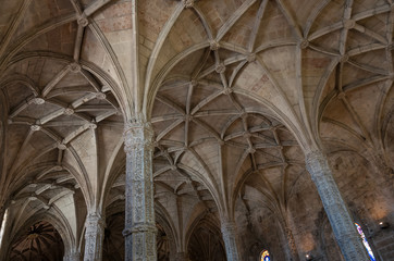 Columns and vaulted ceiling in manuelino style Jeronimos church. Lisbon, Portugal