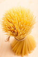 Wheat spaghetti standing tied with rope in bundle.