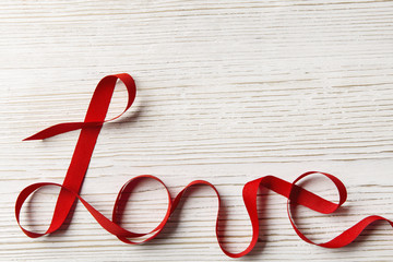 Love Ribbon Word Twisted on White Wood