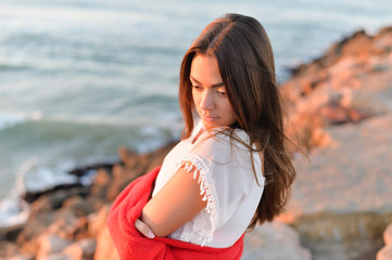 Portrait of romantic beautiful woman in white dress at the sea beach
