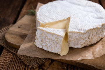 Creamy Camembert on wooden background