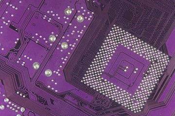 Dusty printed circuit board. High tech closeup. Printed circuit board with paths for micro assembly.