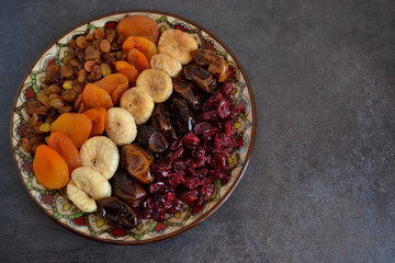Dried fruit in a bowl on a dark background