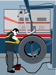 Mechanic repairing tire