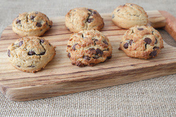 chocolate chip coconut cookies on wooden board