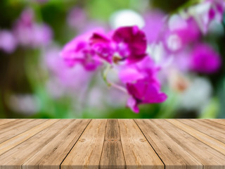Wooden board empty table in front of blurred background. Perspective brown wood over blur flower in forest - can be used for display or montage your products. spring season. vintage filtered image.