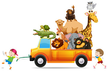 Children pulling a truck loaded with wild animals