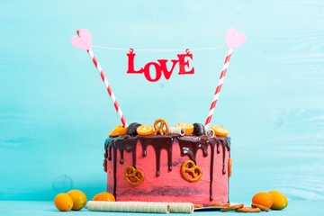 Homemade cake for Valentine's day decorated with word love