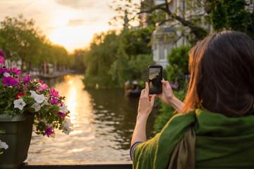 tourist take photos at sunset