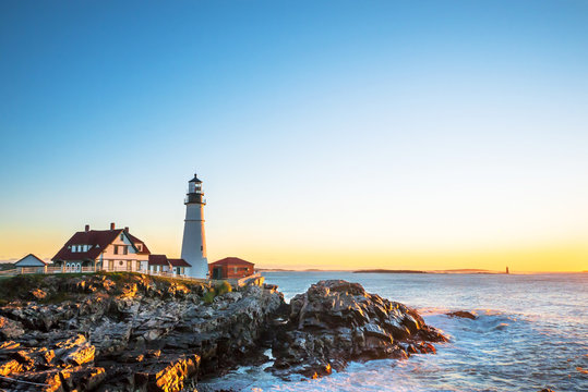 Portland Head Lighthouse at Fort Williams, Maine at sunrise over