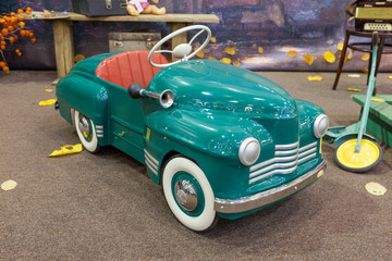 Retro style toy car in a living room