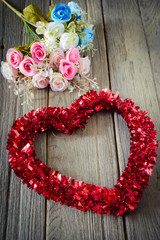 Tinsel heart  decoration on wood background,vintage