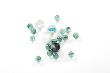 glass marbles balls on white blackground ,selective focus