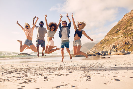 Group of friends on the beach having fun