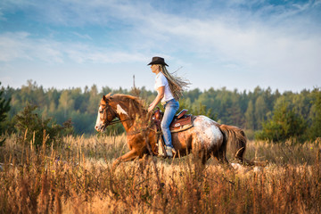 Girl riding on the Appaloosa horse