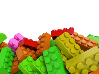Lego toy plastic bricks background in warm colors
