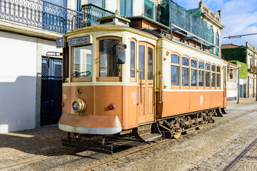 Vintage old retro tram on the street of the town, Porto, Portugal.