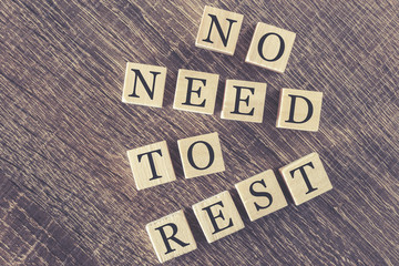 No need to rest message formed with wooden blocks
