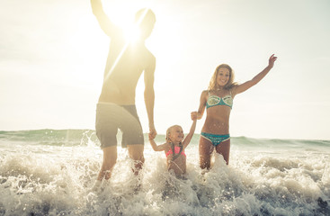 Happy family jumping in the water