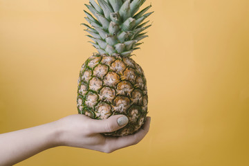 Pineapple in woman's hand