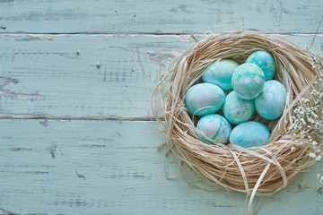 Easter eggs composition in watercolor style - nest via table view