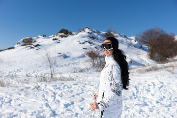 Woman Wearing Ski Goggles on Snow Covered Mountain