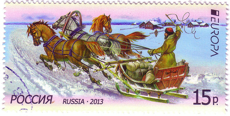 RUSSIA - CIRCA 2013: A stamp printed in Russia shows winter sledgRUSSIA - CIRCA 2013: A postal stamp printed in Russia shows winter sledge race, circa 2013e race, circa 2013