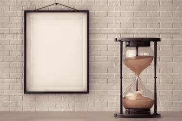 Vintage Sand hourglass in front of Brick Wall with Blank Frame