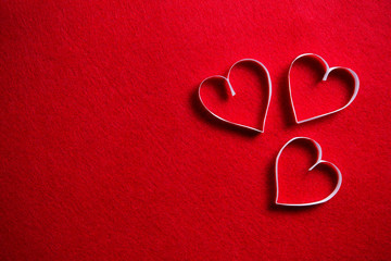 Paper hearts on red background for gift on valentines day.