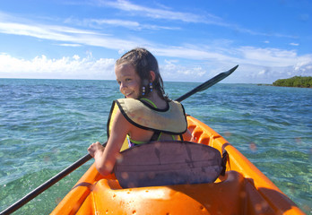 girl kayaking in the caribbean