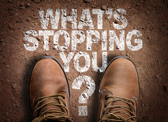 Top View of Boot on the trail with the text: Whats Stopping You?