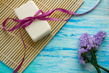 natural organic soap with flowers on  wooden table