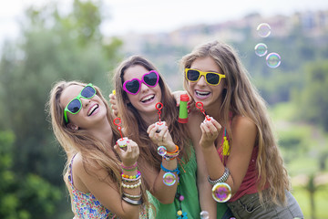 teen girls blowing bubbles
