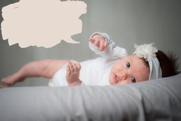 Portrait baby girl lying down speech bubble